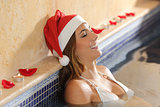 Woman relaxing in a spa on christmas holidays