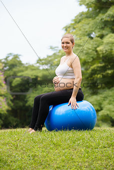 pregnant woman belly swiss fit ball workout park