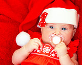 Newborn girl wearing Santa hat