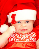 Newborn baby wearing Christmas costume