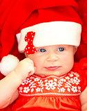 Newborn baby wearing Christmas costume