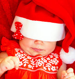 Sweet child wearing Santa hat