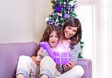 Opening Christmastime gift