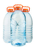 Three big full plastic water bottles with orange caps