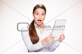 Attractive young woman with tablet.