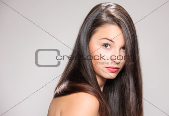 Attractive young woman with brown hair.