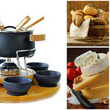 cookware set for fondue , different cheese and a basket of bread