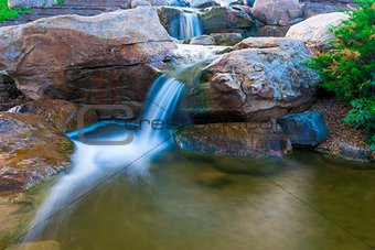 beautiful small waterfall in the park