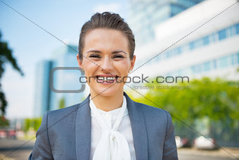 Portrait of business woman in business district