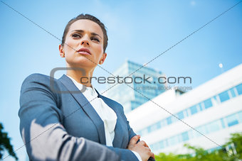 Portrait of serious business woman in front of office building