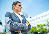 Serious business woman in front of office building