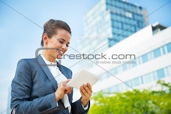 Business woman with tablet pc in office district