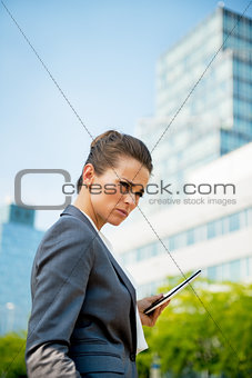 Portrait of serious business woman with tablet pc in office dist