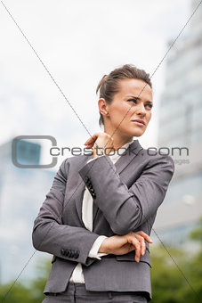 Portrait of serious business woman in office district