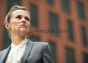 Portrait of confident business woman in front of office building