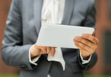 Closeup on business woman using tablet pc