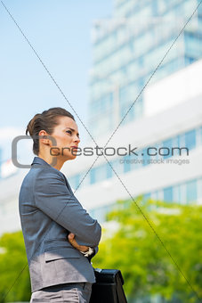 Portrait of thoughtful business woman in office district