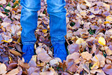 kids feet in autumn leaves