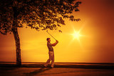 golf player sunset