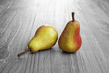 two colorful pears