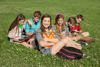 Six Teens Studying Outdoors