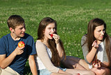 Three Teens Eating Fruit
