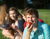 Happy Teen Eating Fruit