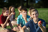 Cheerful Teen Holding Apple