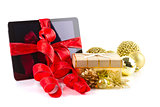 Tablet pc with christmas decorations on white