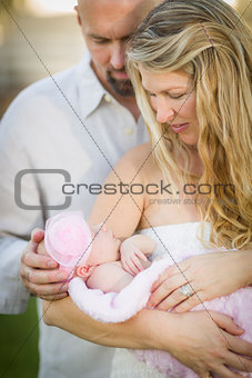Beautiful Young Couple Holding Their Newborn Baby Girl
