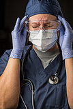 Grimacing Female Doctor or Nurse Wearing Protective Wear