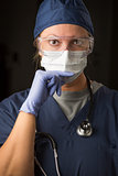 Concerned Female Doctor or Nurse Wearing Protective Facial Wear