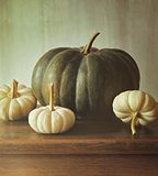 Green pumpkin and small white gourds