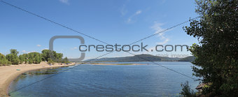 beach on the Volga River with mountain views