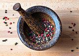 Peppercorns in mortar