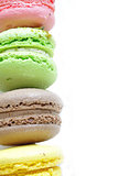 multicolored macaroon - almond cookies on white background