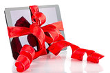 Tablet pc with christmas red ribbon