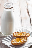 bottle of milk and crackers with honey