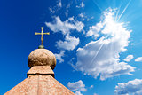 Bronze Cross on Blue Sky