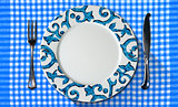 Empty Plate on Tablecloth with Cutlery