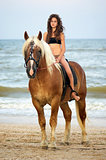 teen girl riding a horse