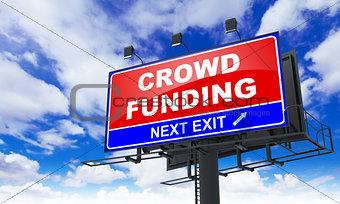 Crowd Funding Inscription on Red Billboard.