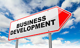 Business Development on Red Road Sign.