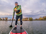 stand up paddling on a lake