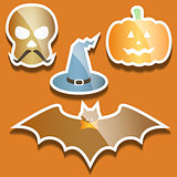 Flat scull, pumpkin, hat and bat
