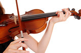 Closeup of violin playing.