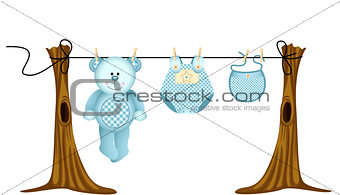 Baby boys clothing with teddy bear on clothesline