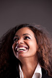 Happy afroamerican girl looking up laughing