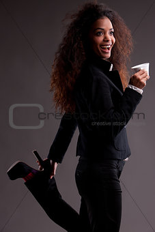 beautiful afroamerican girl with coffee in a strange pose