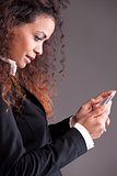 beaufitul afro-american curly girl watching her mobile